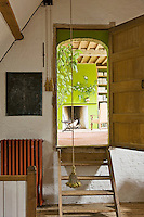 The lime-green chimney breast in the library is glimpsed through the open door from the entrance hall