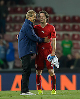 PRAGUE, Czech Republic - September 3, 2014: USA's coach Jurgen Klinsmann and Tomas Rosicky of the Czech Republic during the international friendly match between the Czech Republic and the USA at Generali Arena.