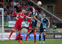 Sean Clohessy of Leyton Orient gives Luke O'Nien of Wycombe Wanderers a shove during the Sky Bet League 2 match between Leyton Orient and Wycombe Wanderers at the Matchroom Stadium, London, England on 19 September 2015. Photo by Andy Rowland.