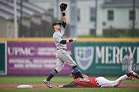 Akron RubberDucks shortstop Ernie Clement (6) stretches for a throw as Cam Gibson (14) slides into second base during an Eastern League game against the Erie SeaWolves on June 2, 2019 at UPMC Park in Erie, Pennsylvania.  Akron defeated Erie 7-2 in the first game of a doubleheader.  (Mike Janes/Four Seam Images)