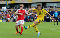 Oxford United's Josh Ruffels clears away from Fleetwood Town's Kyle Dempsey<br /> <br /> Photographer David Shipman/CameraSport<br /> <br /> The EFL Sky Bet League One - Oxford United v Fleetwood Town - Saturday August 11th 2018 - Kassam Stadium - Oxford<br /> <br /> World Copyright &copy; 2018 CameraSport. All rights reserved. 43 Linden Ave. Countesthorpe. Leicester. England. LE8 5PG - Tel: +44 (0) 116 277 4147 - admin@camerasport.com - www.camerasport.com