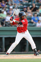 Left fielder Franklin Guzman (10) of the Greenville Drive bats in a game against the Savannah Sand Gnats on Friday, August 22, 2014, at Fluor Field at the West End in Greenville, South Carolina. Greenville won, 6-5. (Tom Priddy/Four Seam Images)