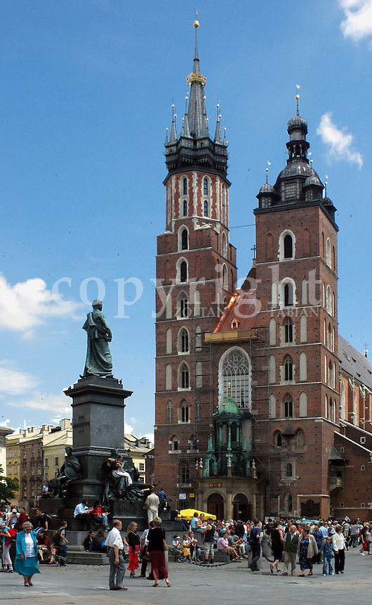 St. Mary's church and the monument of Adam Mickiewicz in Cracow, Poland, Europe