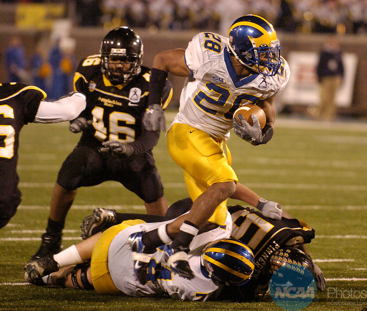 14 DEC 2007: Running back Omar Cuff (28) of the University of Delaware looks for an opening during the Division I-AA Men's Football Championship held at Finley Stadium-Davenport Field in Chattanooga, TN. Appalachian State claimed the national championship with a 49-21 win over the University of Delaware.  Mark Gilliland/NCAA Photos