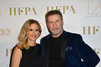 CANNES, FRANCE. May 13, 2018: John Travolta & Kelly Preston at the Hollywood Foreign Press Association Party at Nikki Beach at the 71st Festival de Cannes