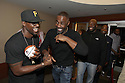 Actors Lance Gross and Idris Elba share a laugh after making a surprise appearance at the Toyota SWAC 2014 Championship Game.