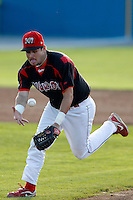 Batavia Muckdogs second baseman Jeremy Patton #12 comes up with the ball during the first game of a doubleheader against the Williamsport Crosscutters at Dwyer Stadium on August 23, 2011 in Batavia, New York.  Batavia defeated Williamsport 2-1.  (Mike Janes/Four Seam Images)