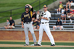 WINSTON-SALEM, NC - JUNE 02: UMBC's Andrew Casali (6) is held on first base by Wake Forest's Gavin Sheets (24). The Wake Forest Demon Deacons hosted the University of Maryland Baltimore County Retrievers on June 2, 2017, at David F. Couch Ballpark in Winston-Salem, NC in NCAA Division I College Baseball Tournament Winston-Salem Regional Game 2. Wake Forest won the game 11-3.