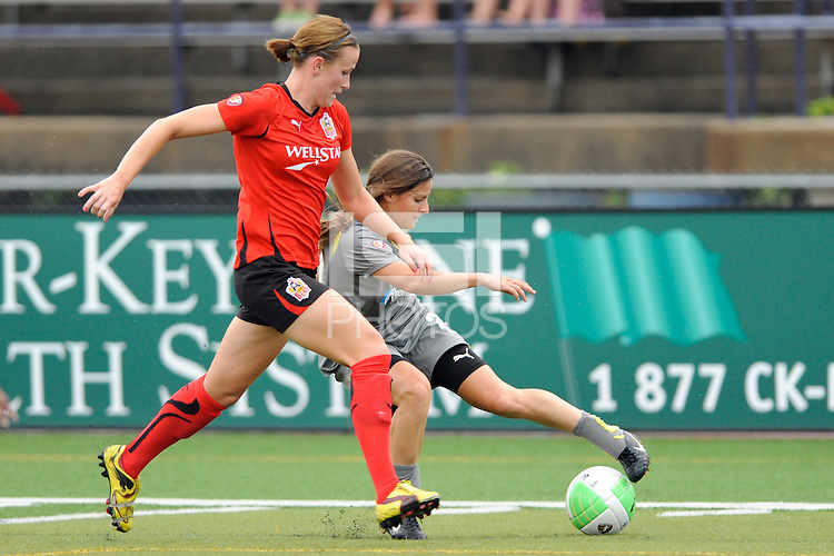 Tina DiMartino (25) of the Philadelphia Independence plays the ball as Leigh Ann Robinson (7) of the Atlanta Beat defends during a Women's Professional Soccer (WPS) match at John A. Farrell Stadium in West Chester, PA, on August 15, 2010.
