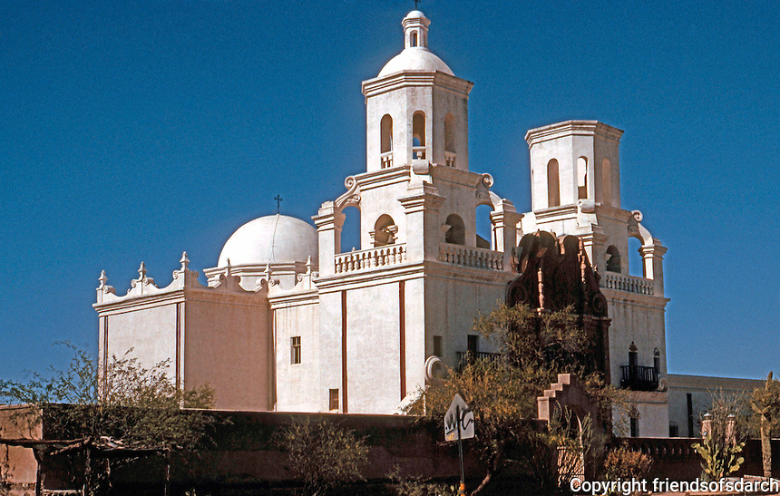 AZ: Tucson--San Xavier Del Bac, SW 3/4 elevation. Facade in late afternoon light. c. 1783.  Photo '96.