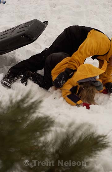 Todd Rimmasch, Nathaniel Nelson sledding at Sugarhouse park<br />
