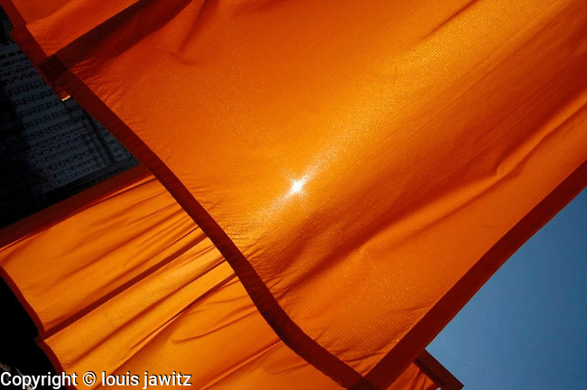 "Christo and Jeanne-Claude's art, The Valley Curtain with saffron"" colored fabric, transformed NYC Central Park into an enormous art installation in 2/05"