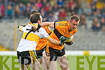 Stacks veteran William Kirby goes past Crokes Shane Myers during their quarter final clash in Fitzgerald Stadium on Sunday