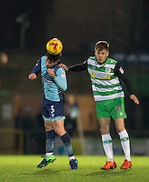 Joe Jacobson of Wycombe Wanderers heads clear of Brendon Goodship of Yeovil Town during the Sky Bet League 2 match between Wycombe Wanderers and Yeovil Town at Adams Park, High Wycombe, England on 14 January 2017. Photo by Andy Rowland / PRiME Media Images.