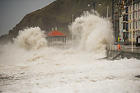 Pictured: Waves crash against the seaside town of Aberystwyth, Wales, UK. Saturday 21 October 2017<br /> Re: Coastal parts of the UK is facing winds of up to 70mph as Storm Brian causes roads to close and public transport to be cancelled.<br /> Roads in Aberystwyth's seafront and at nearby Aberaeron, Wales are shut on Saturday morning as a yellow &quot;be aware&quot; Met Office warning is in place.<br /> Seven flood warnings have been issued for the west Wales coast.