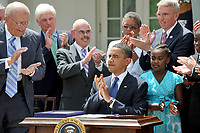 Washington, D.C. - June 22, 2009 -- United States President Barack Obama joins the applause after signing the Family Smoking Prevention and Tobacco Control Act in the Rose Garden of the White House on Monday, June 22, 2009. From left to right: U.S. Representative John Dingell (Democrat of Michigan), U.S. Senator Chris Dodd (Democrat of Connecticut), U.S. Representative Henry Waxman (Democrat of California), President Obama, and representatives from the Campaign for Tobacco Free Kids.Credit: Ron Sachs/CNP/AdMedia