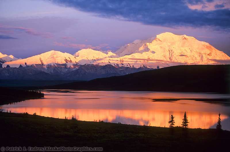 Mt. Denali, orange alpenglow on Denali's north face, Denali National Park, Alaska.