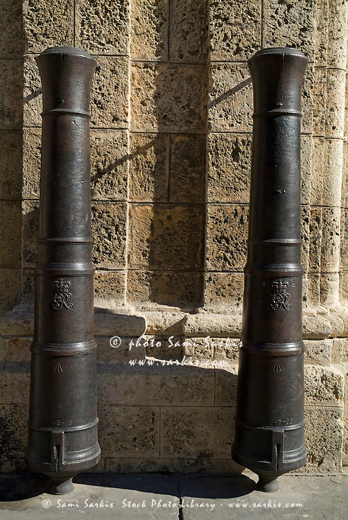 Cannons on a wall near Plaza de Armas in Havana, Cuba.