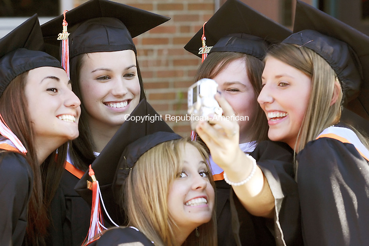 WATERTOWN, CT--15 JUNE 2007--061507TJ14 - Bre Lampron, center, tries to sneak in to a picture of, from left, Armelia Hasa, Haley Reinprecht, Taylor Boucher, holding the camera, and Ashley Lutter while waiting for the Watertown High School commencement to begin on Friday, June 15, 2007. T.J. Kirkpatrick/Republican-American