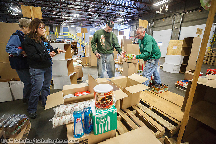 Iditarod volunteers sort and repackage human food and supplies for the trail volunteers to eat and use at each of the checkpoints on the 2017 Iditarod. The sorting is going on at the Airland Transport warehouse facilities in Anchorage Alaska on Friday  February 17, 2017.<br /> <br /> <br /> <br /> Photo by Jeff Schultz/SchultzPhoto.com  (C) 2017  ALL RIGHTS RESVERVED