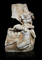 Roman Sebasteion relief sculpture of Nero conquering Armenia Aphrodisias Museum, Aphrodisias, Turkey.   Against a black background.<br /> <br /> Nero, wearing only a cloak and sword strap, supports a slumped naked Armenia by her upper arms. She wears a soft eastern hat, and her bow and quiver are next to her. The heroic composition likens them to Achilles and the Amazon Queen Penthesilea. The inscription reads: Armenia - (Neron) Klaudios Drousos Kaisar Sebastos Germanikos.
