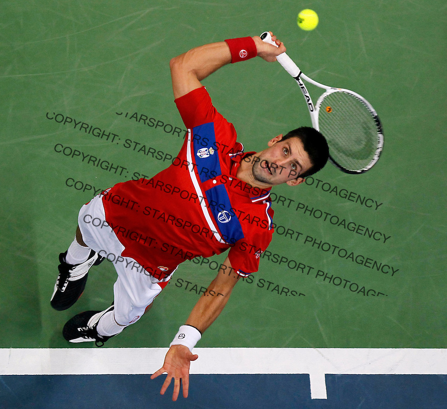 Serbia's Davis Cup team player Novak Djokovic serve the ball during second match of the Davis Cup finals Serbia vs France against Gilles Simon in Belgrade Arena in Belgrade, Serbia, Friday, 3. December 2010. (credit & photo: Srdjan Stevanovic/Starsportphoto.com)