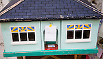 """Model toy house with humorous label saying 'No chain"""" a term used within property transactions in Britain"""
