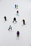 USA, Colorado, Aspen, skiers under the Exhibition Ski Lift, Aspen Highlands Ski Resort