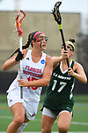 TAMPA, FL - MAY 20: Dani Bursinger #15 of the Florida Southern Mocs and Nicole Delany #17 of the Le Moyne Dolphins battle for the ball during the Division II Women's Lacrosse Championship held at the Naimoli Family Athletic and Intramural Complex on the University of Tampa campus on May 20, 2018 in Tampa, Florida. Le Moyne defeated Florida Southern 16-11 for the national title. (Photo by Jamie Schwaberow/NCAA Photos via Getty Images)