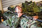 Apr. 19 2010 - BANGKOK, THAILAND: A Thai soldier sleeps in the Sala Daeng Skytrain station in the Silom financial district of Bangkok Monday. Hundreds of Thai soldiers, including reservists and front line units, and riot police moved into the Silom financial district Monday, not far from the red-shirts' main protest rally site, in Ratchaprasong. The heavy show of force is to prevent the Red Shirts from entering the Silom area. Many of soldiers were greeted as heros by workers in the area, who oppose the Red Shirts.   Photo by Jack Kurtz