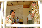Iraqi police and army listen to an interpreter during a lecture on search techniques delivered by a British Army Royal Engineer at Shaibah Logistics base near Basrah City.