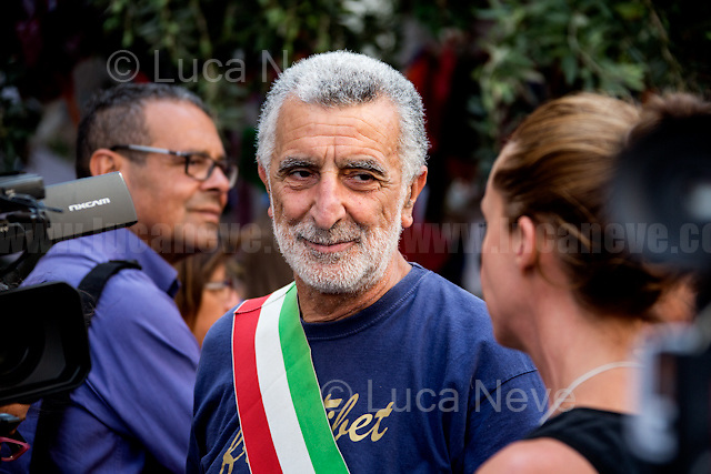 """Renato Accorinti - Mayor of Messina.<br /> <br /> Palermo (Sicily - Italy), 19/07/2017. """"Basta depistaggi e omertà di Stato!"""" (""""Stop disinformation and omertá by the State!"""") (1). Public event to commemorate the 25th Anniversary of the assassination of the anti-mafia Magistrate Paolo Borsellino along with five of his police """"scorta"""" (Escorts from the special branch of the Italian police force who protect Judges): Agostino Catalano, Emanuela Loi (The first Italian female member of the police special branch and the first woman of this branch to be killed on duty), Vincenzo Li Muli, Walter Eddie Cosina and Claudio Traina. The event was held at Via D'Amelio, the road where Borsellino was killed. Family members of mafia victims, amongst others, made speeches about their dramatic experiences, mafia violence and unpunished crimes, State cover-ups, silence ('omertá'), and misinformation. Speakers included, amongst others, Vincenzo Agostino & Augusta Schiera, Salvatore & Cristina & Antonella Catalano, Graziella Accetta & Ninni Domino, Massimo Sole, Paola Caccia, Luciano Traina, Gianluca & Angela Manca, Nunzia & Stefano Mormile, Ferdinando Imposimato, Judge Nino Di Matteo. The event ended with the screening of the RAI docu-fiction, 'Adesso Tocca A Me' ('Now it's My Turn' - Watch it here: http://bit.ly/2w3WJUX ) by G. Filippetto & F. Miccichè.<br /> <br /> For more info & a video of the event please click here: http://bit.ly/2eQfNT3 & http://bit.ly/2eQbmrj & http://19luglio1992.com & http://bit.ly/2he8hCj<br /> <br /> (1) 'Omerta' is the term used in Italy to refer to the code of silence used by mafia organisations, as well as the culture of silence that is entrenched in society at large (especially among victims of mafia crimes, as they fear recriminations), about the existence of organised crime and its activities."""