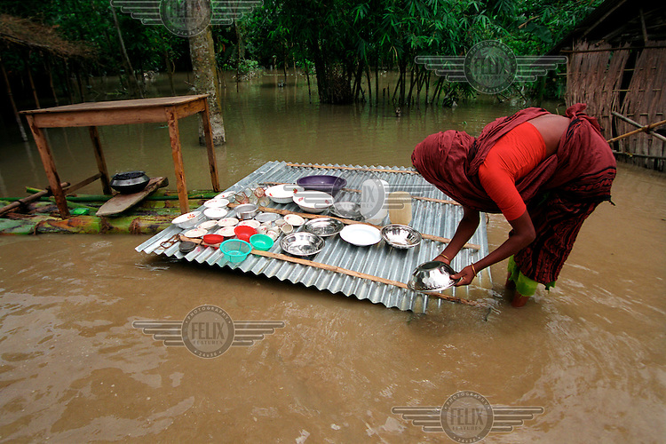 Kitchen utensils drying on a bamboo platform. Monsoon rains caused flooding in 40 of Bangladesh's 64 districts, displacing up to 30 million people and killing several hundred.