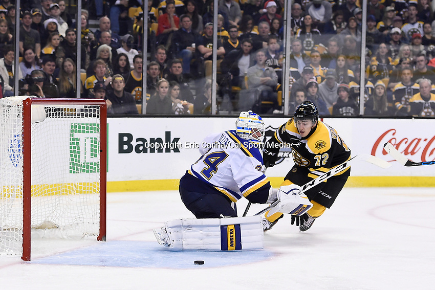 Tuesday, December 22, 2015: Boston Bruins center Frank Vatrano (72) watches the puck go wide of St. Louis Blues goalie Jake Allen (34) during the National Hockey League game between the St. Louis Blues and the Boston Bruins held at TD Garden, in Boston, Massachusetts. The blues beat the Bruins 2-0 in regulation time. Eric Canha/CSM