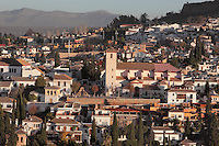 Church of San Nicolas, originally built in the 16th century in Mudejar style but rebuilt 1932 after a fire, and El Albayzin, the medieval Moorish old town of Granada, seen from the Alhambra Palace, Granada, Andalusia, Southern Spain. From the 8th to the 15th centuries, Granada was under muslim rule and retains a distinctive Moorish heritage. Granada was listed as a UNESCO World Heritage Site in 1984. Picture by Manuel Cohen