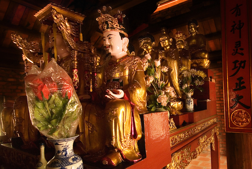 Buddhas sit at Fish Island Pagoda in northern Vietnam.