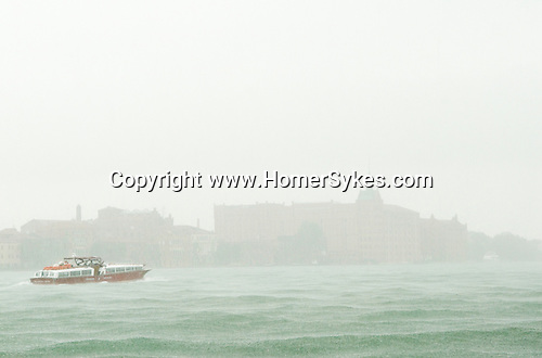 Venice Italy 2009. Rain. Water transport La Giudecca.