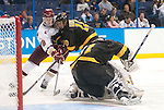 March 25,  2011             Boston College forward Jimmy Hayes (10) tries to shoot on goal as he's blocked by Colorado College defenseman Gabe Guentzel (10) in front of Colorado College goalie Joe Howe (31) in the second period. The Boston College Eagles played against the Colorado College Tigers in the second semifinal of the NCAA Division 1 Men's West Regional Hockey Tournament, on Friday March 25, 2011 at the Scottrade Center in downtown St. Louis.