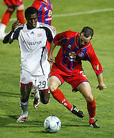"""Crystal Palace defender Paul Robson (3) and New England Revolution forward Abdoulie """"Kenny"""" Mansally (29) battle for the ball. The New England Revolution (MLS) defeated Crystal Palace FC USA of baltimore (USL2) 5-3 in penalty kicks after finishing regulation and overtime tied at 1-1 during a Lamar Hunt US Open Cup quarterfinal match at Veterans Stadium in New Britain, CT, on July 8, 2008."""