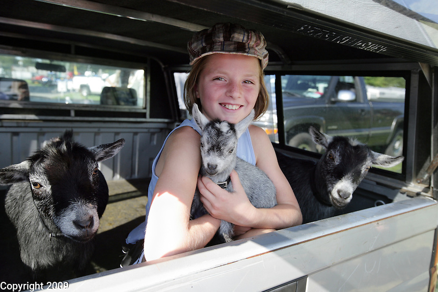 Heidi Greenwood, 8, Custer, Wash., waits in the back of her family's truck with her goats for entry to the NW Washington Fair in August 16, 2009. Photo by Meryl Schenker..         .