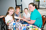 Rebecca Cains who is face painting the children at Baile Mhuire  Family Day on Saturday, also in the picyure is Brenda Hartnett O'Connell, Aishling O'Connell and Aoife O'Connell