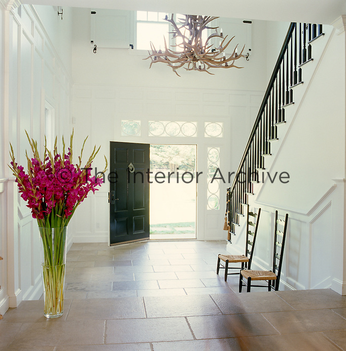 The spacious double-height entrance hall is the ideal location for an ornate, outsize chandelier made of antlers