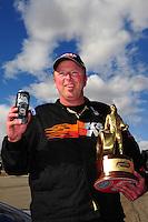 Apr. 1, 2012; Las Vegas, NV, USA: NHRA comp eliminator driver Dan Fletcher celebrates after winning the Summitracing.com Nationals at The Strip in Las Vegas. Mandatory Credit: Mark J. Rebilas-