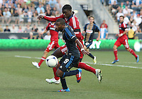 CHESTER, PA - AUGUST 12, 2012:  Raymon Gaddis (28) of the Philadelphia Union battles for the ball with  Jalil Anibaba (6) of the Chicago Fire during an MLS match at PPL Park, in Chester, PA on August 12. Fire won 3-1.