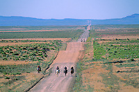 "Riders on long, hot and dusty rez road during the ""Water Is Life"" Ride, 7/16/05, South of Cottonwood Chapter House, Navajo Indian Nation, Arizona, AGPix_0629.."