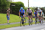 Dan Martin (Garmin-Sharp) riding through the feed zone during the Irish National Men's Elite Road Race Championships held over an undulating course featuring 9 laps centered in the village of Multyfarnham, Co.Westmeath, Ireland. 29th June 2014.<br /> Picture: Eoin Clarke www.newsfile.ie