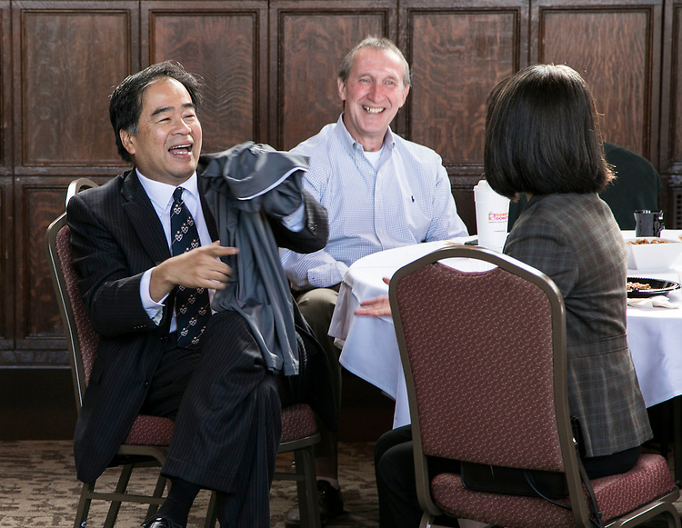 DePaul president A. Gabriel Esteban, Ph.D., receives a shirt from DePaul's facility operations department as he and his wife, Josephine, joined Bob Janis, center, vice president for facility operations, and members of the department for breakfast Friday, Aug. 25, 2017. Dr. Esteban fielded questions from the group of approximately 100 staff members at Cortelyou Commons on the Lincoln Park Campus. (DePaul University/Jamie Moncrief)