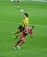 25.05.2013 London, England. Mats Hummels, Borussia Dortmund, in action against Mario Mandzukic, Bayern Munich in the 2013 UEFA Champions League Final between Bayern Munich and Borussia Dortmund from Wembley Stadium. Picture Credit: Tommy Grealy/actionshots.ie