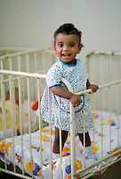 Child in charity care home for children abandoned or who are HIV positive and could develop AIDS, in Sao Paulo, Brazil