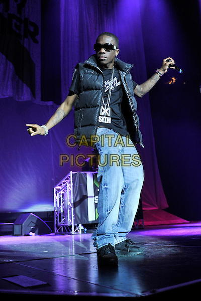 TINCHY STRYDER (Kwasi Danquah).Live at the O2 Arena, London, England, UK, 3rd February 2011..music concert live on stage concert gig  performing full length black puffa puffer bodywarmer jeans hand sunglasses dancing .CAP/MAR.© Martin Harris/Capital Pictures.